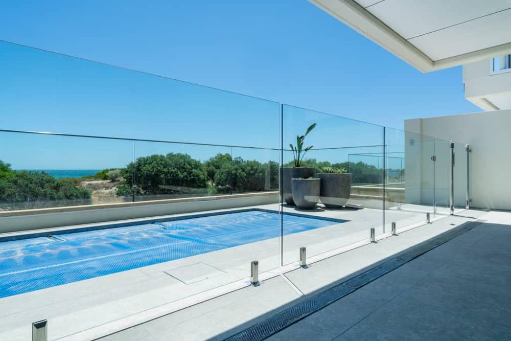 Frameless Glass Pool Fencing with Mirror Spigots