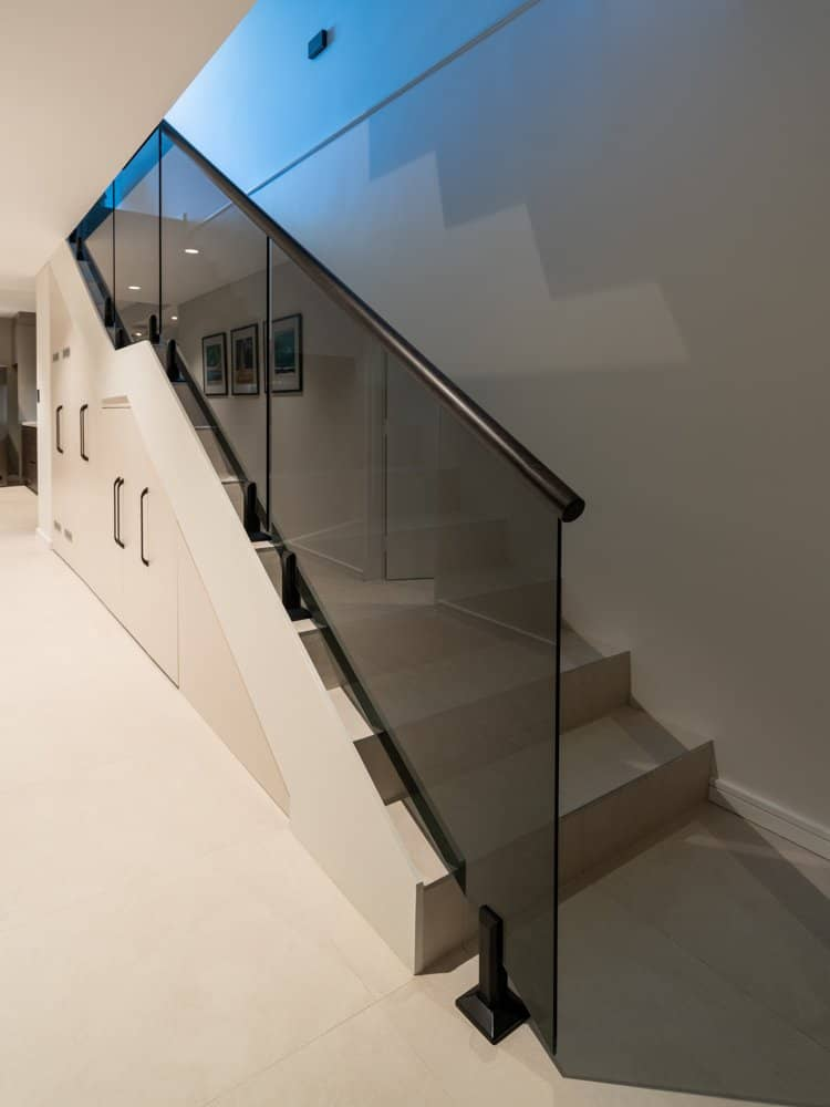 Grey Glass Balustrade with Top Black Timber Handrail